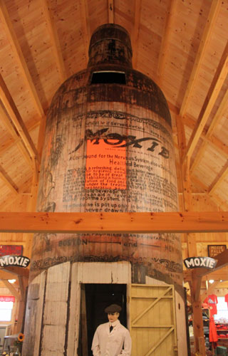 30-foot-tall wooden Moxie bottle, once used as a soda stand